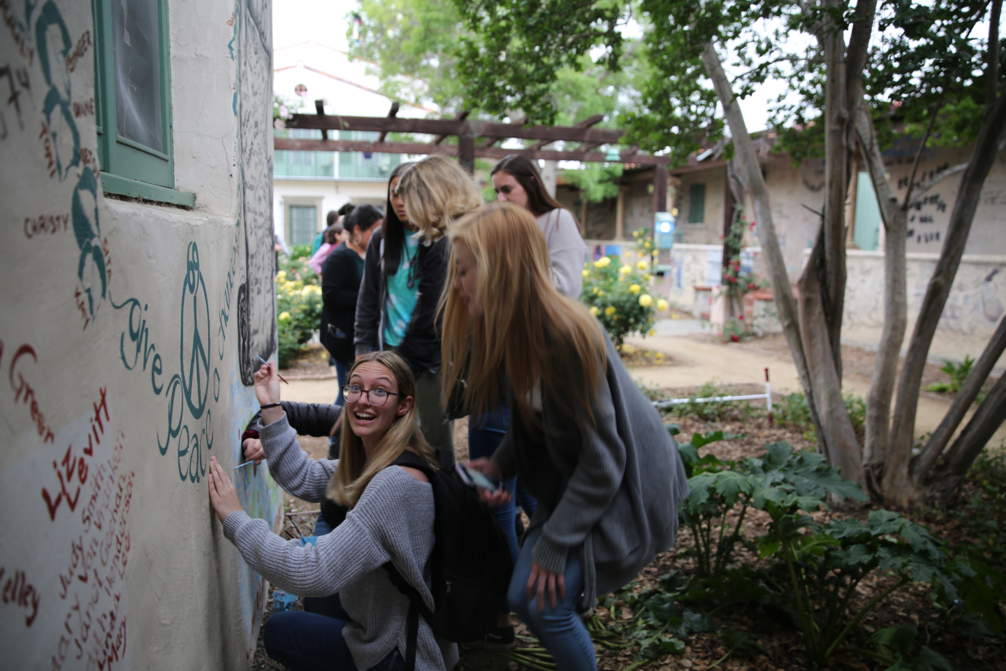 Image of student signing Graffiti Wall