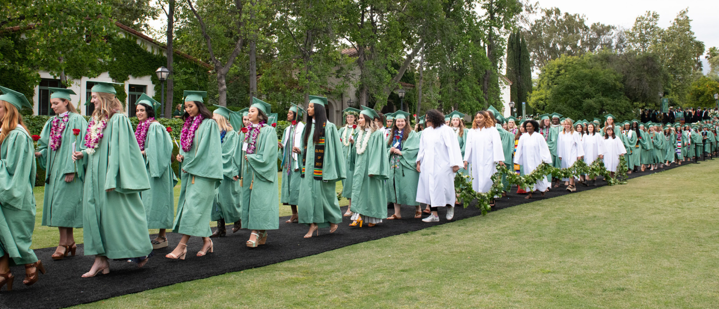 Image of Scripps students in cap and gown during commencement