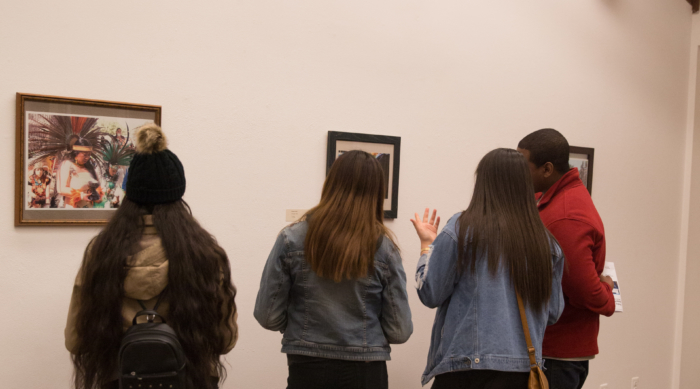 Students admire artwork.
