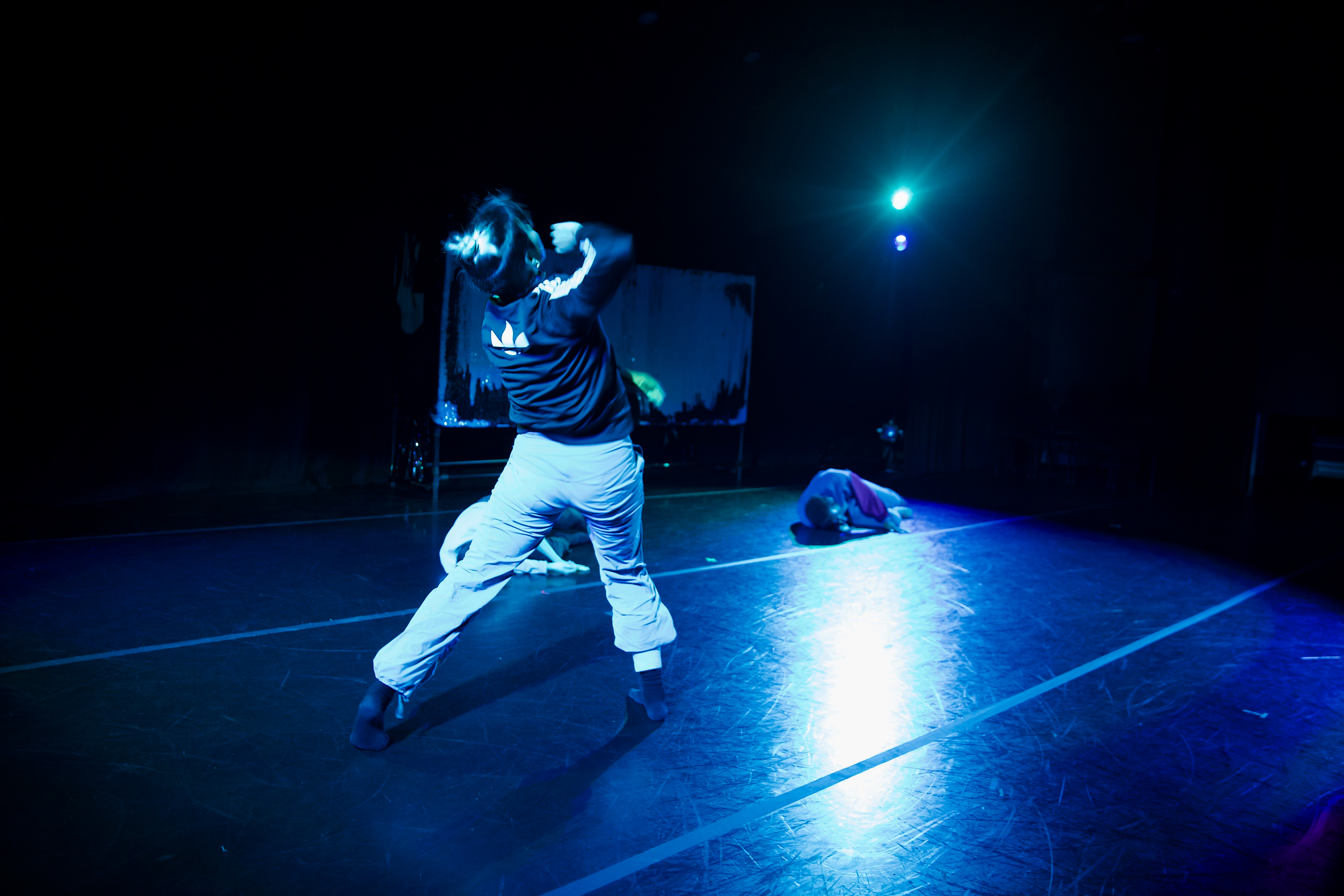 A person performing dance on stage.