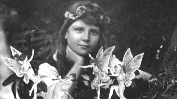 A photograph taken by Elsie Wright in 1917 shows her cousin, Frances Griffiths, visited by fairies.