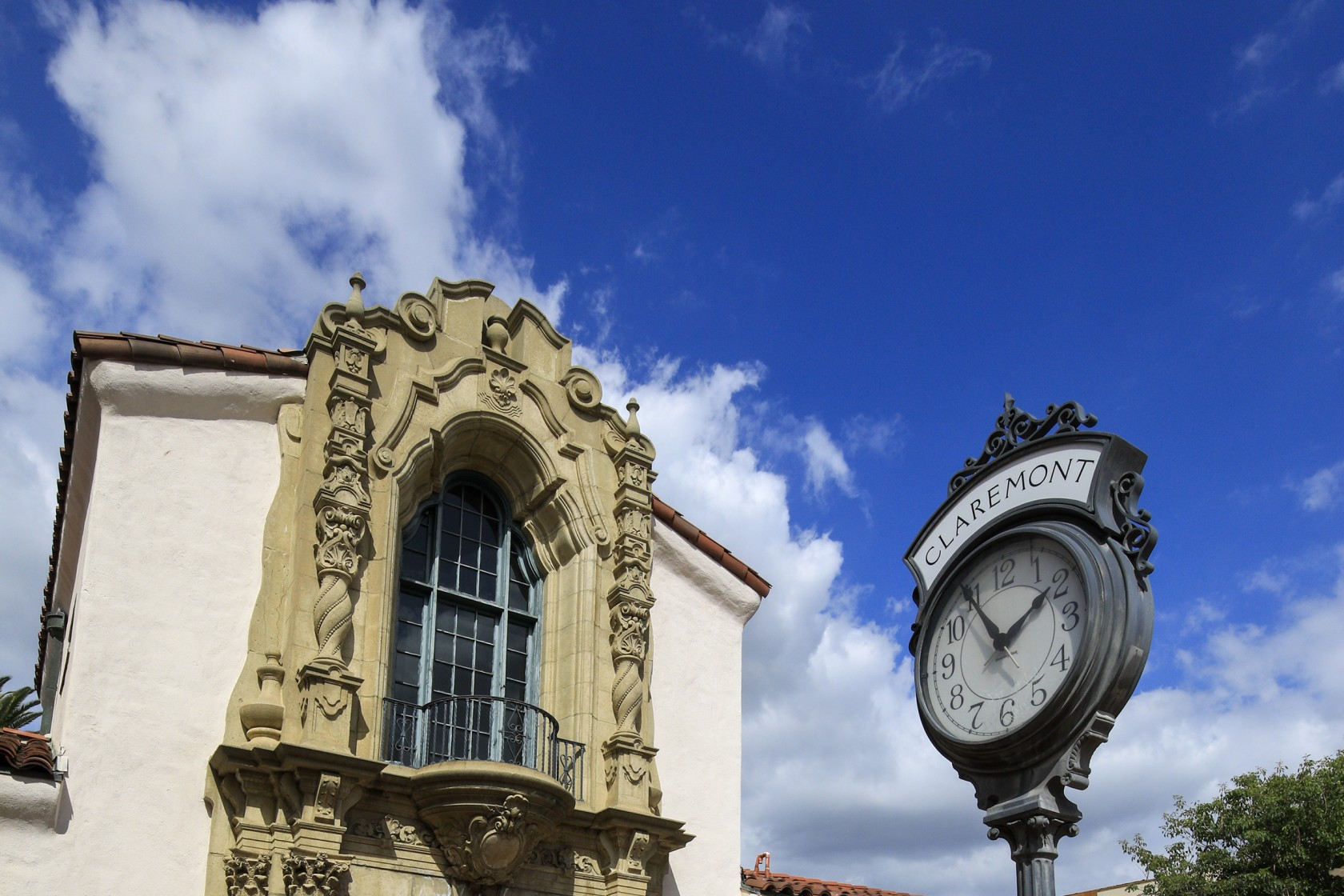 A clock outside a historic building in Claremont.