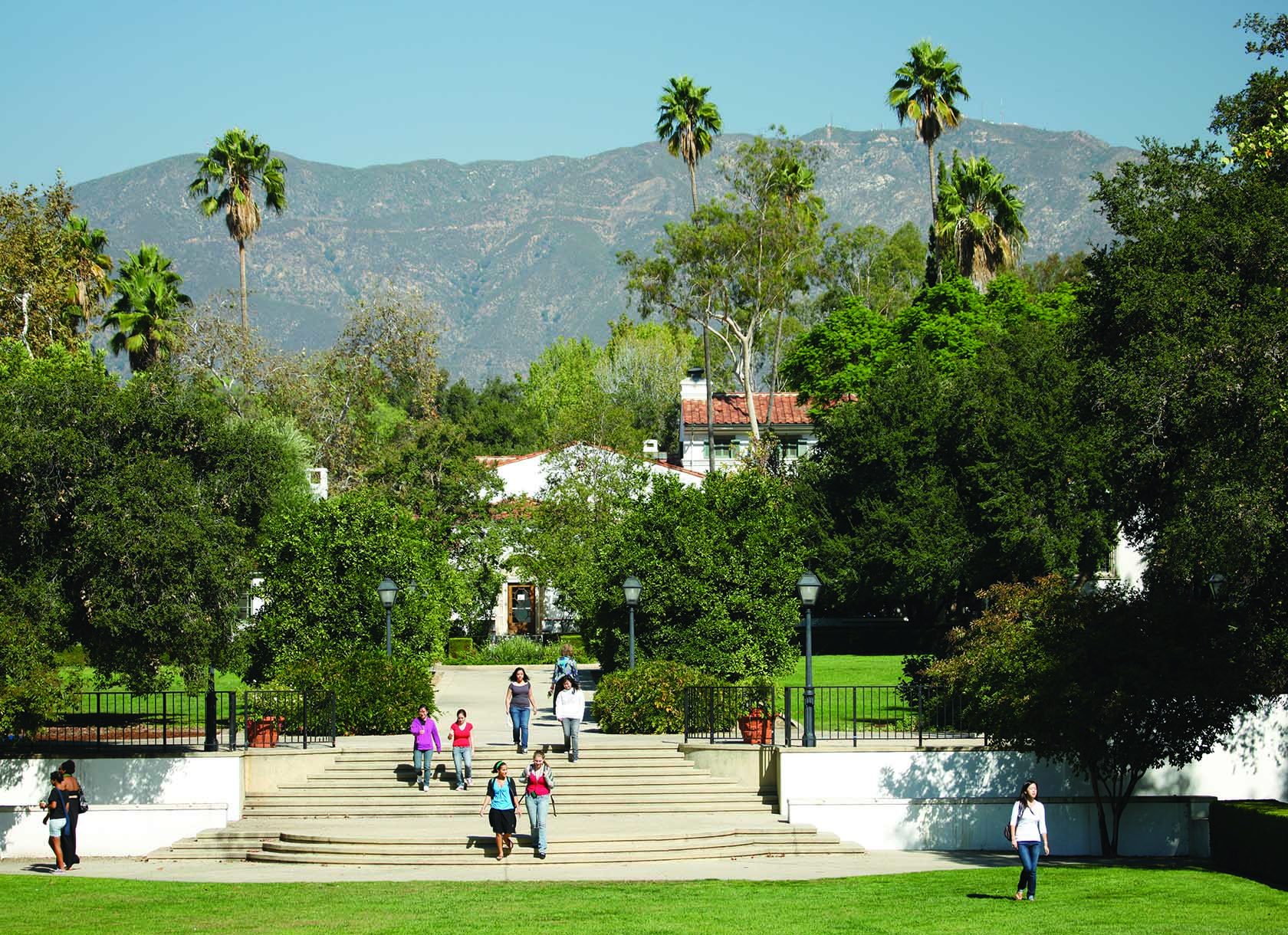 View of bowling green and wood steps with mountains in the background