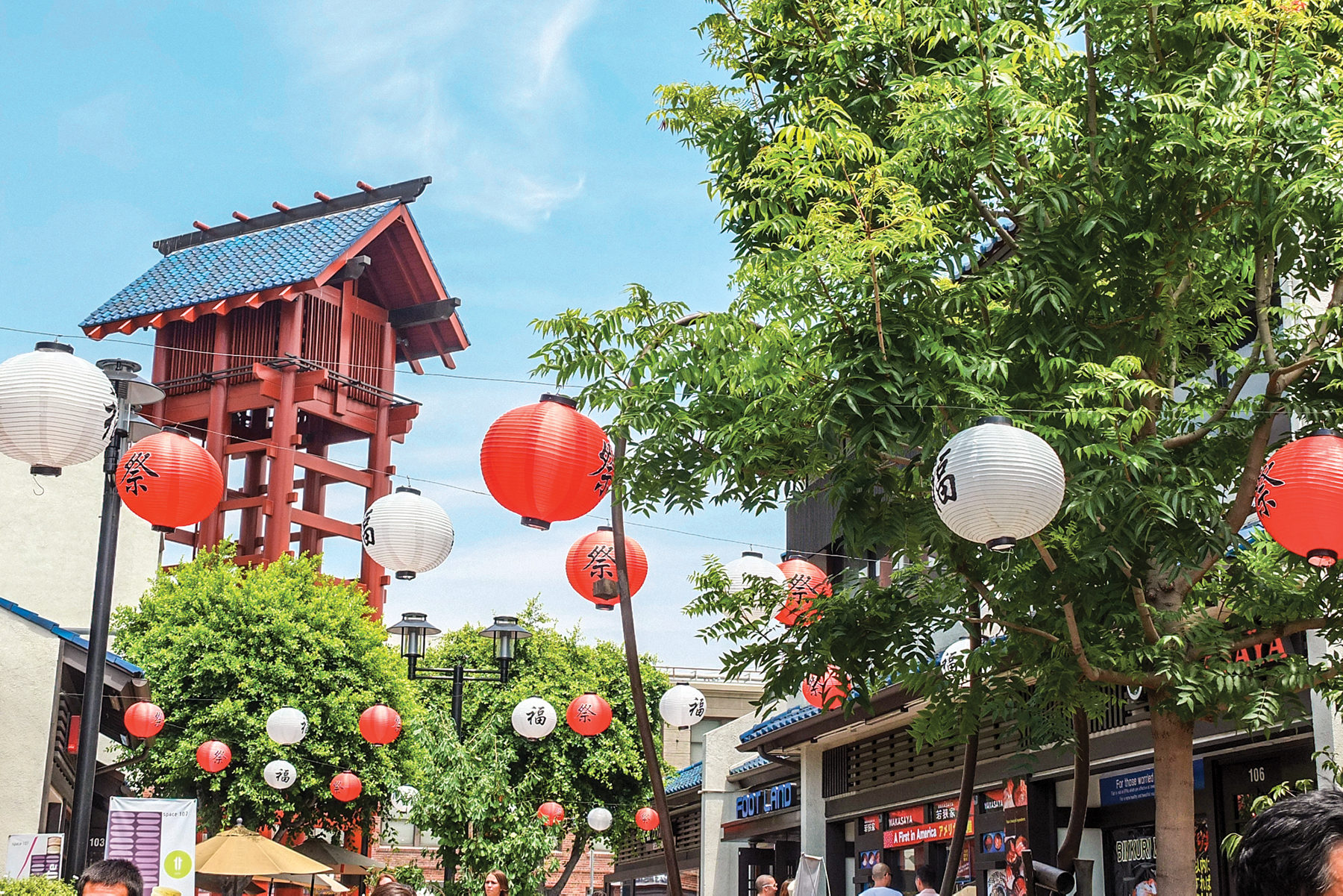 Red and white lanterns hanging in Little Tokyo on a sunny day.