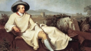 A painting of a white man wearing a white robe and pantaloons sitting amidst ancient ruins.
