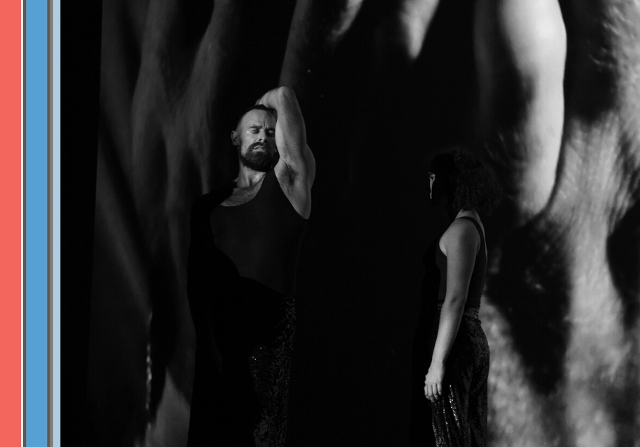 A black and white photo of a bearded man and a woman with short hair dancing.