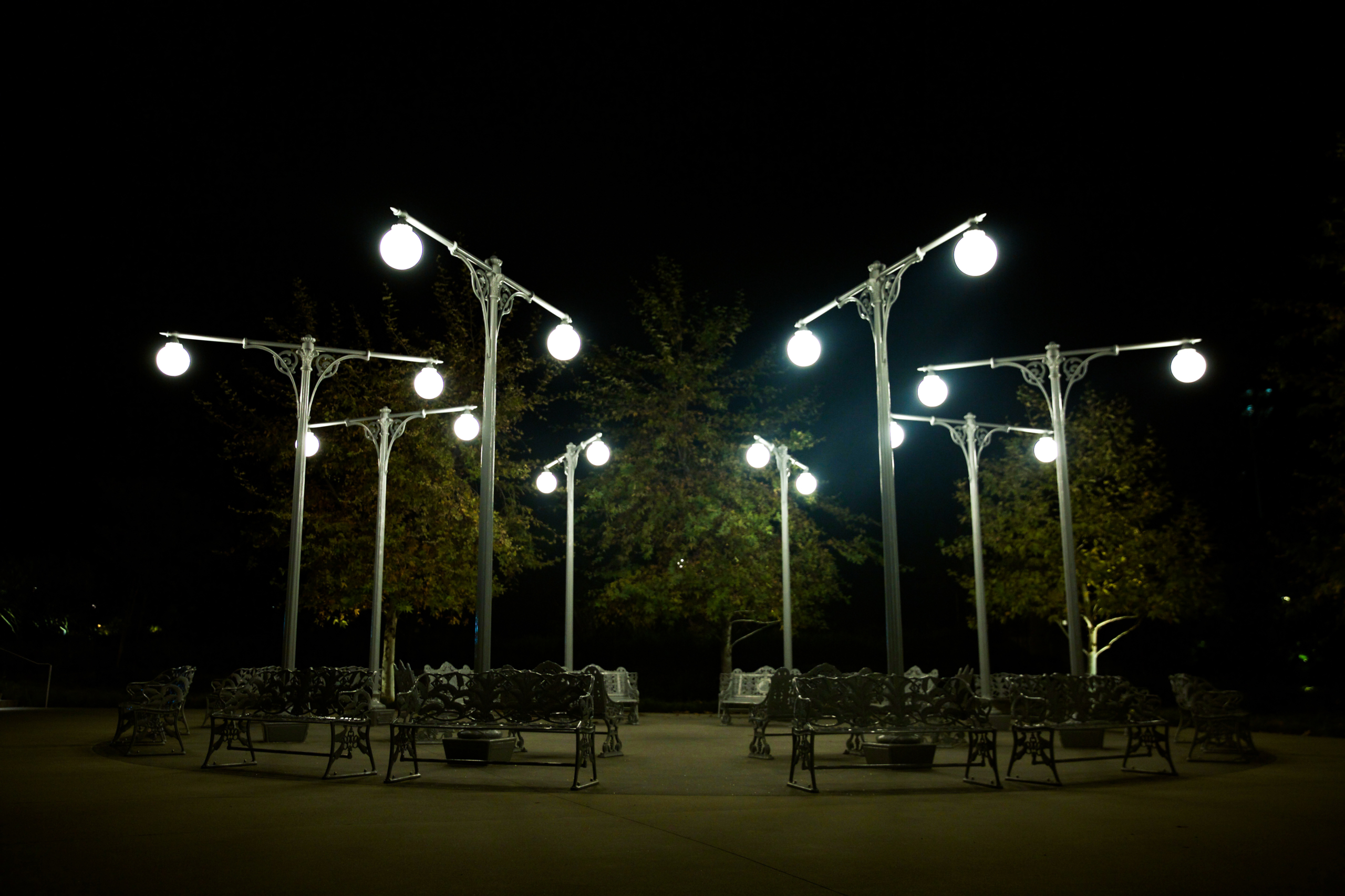 Street lamps and benches arranged in a circle.