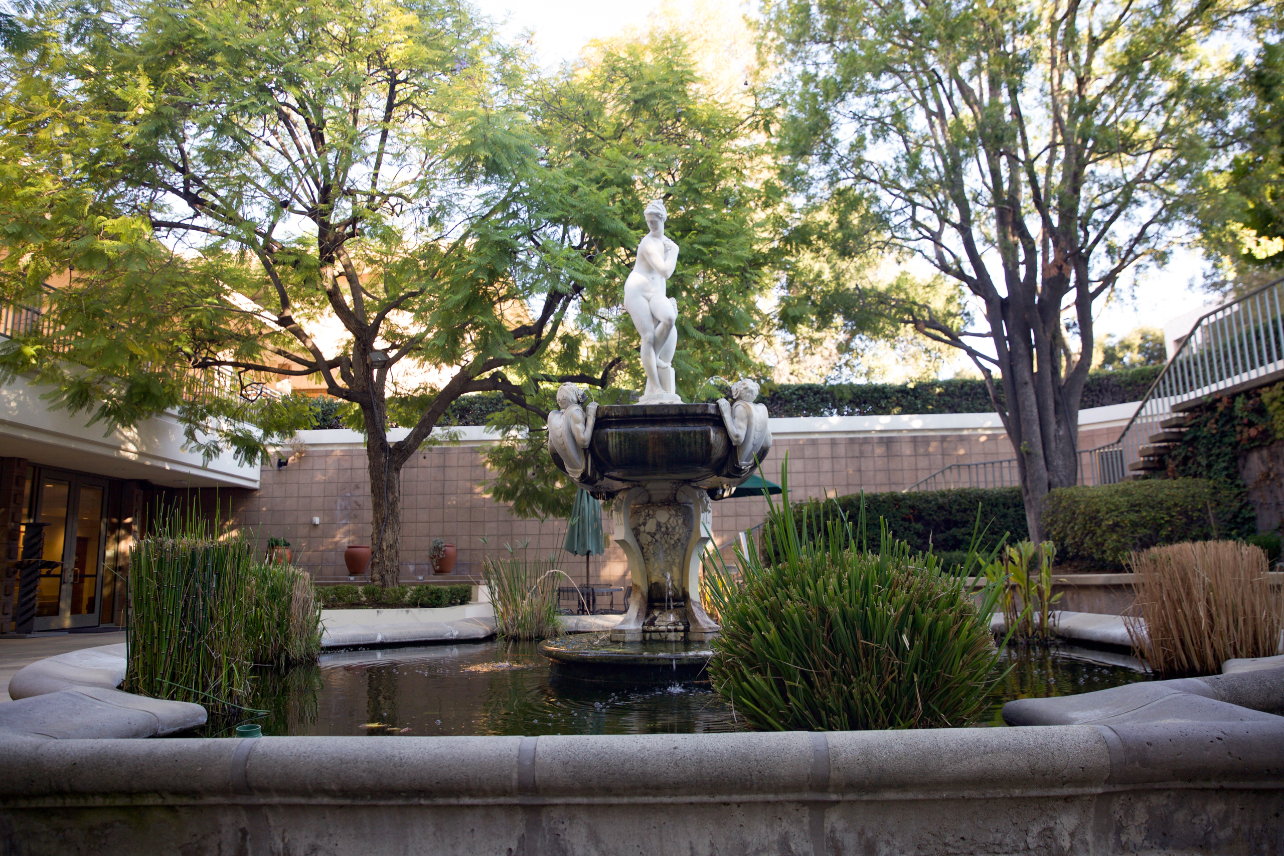 A fountain topped with a statue of a woman.