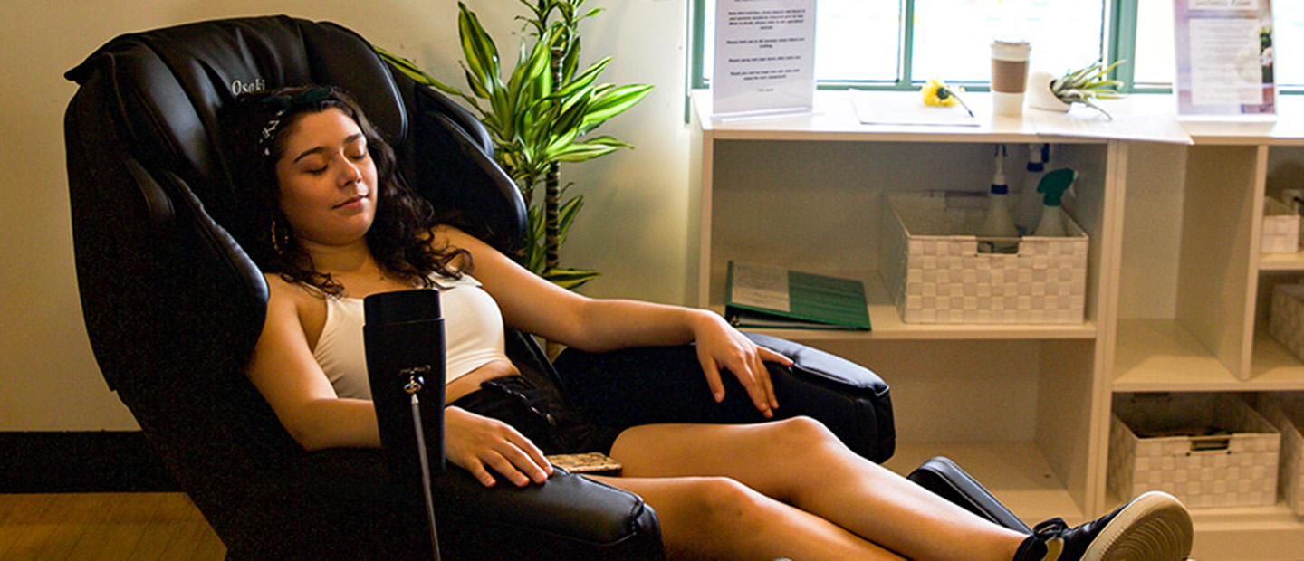 Scripps student relaxing in health and wellness room.